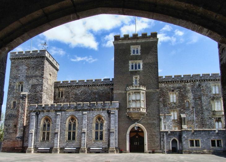 Powderham Castle through arch
